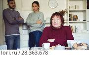Купить «Offended elderly mother dont speaking with adult children during home quarrel», видеоролик № 28363678, снято 21 декабря 2017 г. (c) Яков Филимонов / Фотобанк Лори