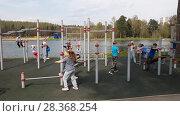 Купить «Moscow, Russia - May 02. 2018. Children playing at sports complex on school lake in green countryside Zelenograd», видеоролик № 28368254, снято 2 мая 2018 г. (c) Володина Ольга / Фотобанк Лори
