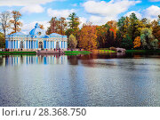"Autumn landscape with view over a garden pavilion ""Grotto"" and the humpback bridge in the Catherine Park, Pushkin, Saint-Petersburg. Редакционное фото, фотограф Николай Лемешев / Фотобанк Лори"