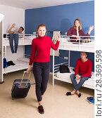 Купить «Female traveler leaving hostel», фото № 28369598, снято 22 марта 2018 г. (c) Яков Филимонов / Фотобанк Лори