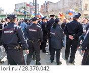Купить «Police officers block an Leningradskaya street during an opposition protest rally», фото № 28370042, снято 5 мая 2018 г. (c) FotograFF / Фотобанк Лори