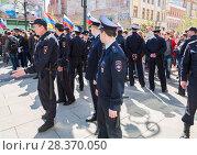 Купить «Police officers block an Leningradskaya street during an opposition protest rally», фото № 28370050, снято 5 мая 2018 г. (c) FotograFF / Фотобанк Лори
