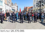 Купить «Police officers block an Leningradskaya street during an opposition protest rally», фото № 28370086, снято 5 мая 2018 г. (c) FotograFF / Фотобанк Лори