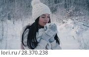 Купить «The girl is drinking tea», видеоролик № 28370238, снято 16 февраля 2018 г. (c) Kozub Vasyl / Фотобанк Лори