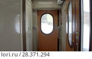 Купить «Interior of the vestibule of a passenger train car», видеоролик № 28371294, снято 23 марта 2018 г. (c) Андрей Радченко / Фотобанк Лори