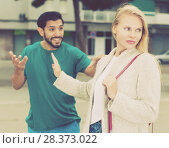 Купить «Husband and wife are emotional quarreling», фото № 28373022, снято 10 августа 2017 г. (c) Яков Филимонов / Фотобанк Лори