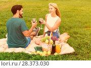 Купить «Couple are talking and drinking wine in time picnic outdoor», фото № 28373030, снято 27 июня 2019 г. (c) Яков Филимонов / Фотобанк Лори