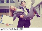 Купить «Boss is carry woman manager on hands because they are satisfied of successful contract», фото № 28373110, снято 20 августа 2017 г. (c) Яков Филимонов / Фотобанк Лори