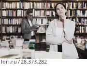 Купить «pensive girl in interior of bookstore», фото № 28373282, снято 18 января 2018 г. (c) Яков Филимонов / Фотобанк Лори