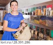 Купить «Customer carrying shopping bag», фото № 28391286, снято 13 июня 2017 г. (c) Яков Филимонов / Фотобанк Лори