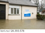 Купить «Ambleside Ambulance Station surrounded by flood waters by the banks of the River Rothay in Ambleside, in the Lake District on Saturday 5th December 2015...», фото № 28393578, снято 22 сентября 2018 г. (c) Nature Picture Library / Фотобанк Лори