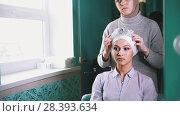 Купить «Muslim woman puts a tiara on the beautiful muslim bride's head», фото № 28393634, снято 15 августа 2018 г. (c) Константин Шишкин / Фотобанк Лори