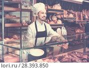 Купить «Man baker showing warm tasty croissant», фото № 28393850, снято 26 января 2017 г. (c) Яков Филимонов / Фотобанк Лори