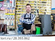Купить «Worker displaying his tools for making keys», фото № 28393862, снято 2 февраля 2017 г. (c) Яков Филимонов / Фотобанк Лори