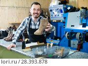Купить «Cheerful worker displaying result of his work», фото № 28393878, снято 2 февраля 2017 г. (c) Яков Филимонов / Фотобанк Лори