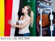 Купить «female looking at carpet flooring», фото № 28393994, снято 15 июля 2018 г. (c) Яков Филимонов / Фотобанк Лори