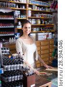 Купить «seller standing at counter», фото № 28394046, снято 4 августа 2020 г. (c) Яков Филимонов / Фотобанк Лори