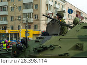 Perm, Russia - May 09, 2018: BTR-82 armored personnel carrier with a crew on a city street after the Victory Day parade. Редакционное фото, фотограф Евгений Харитонов / Фотобанк Лори