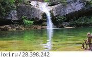 Купить «El Torrent de la Cabana small mountain stream with crystal clear water», видеоролик № 28398242, снято 16 мая 2017 г. (c) Яков Филимонов / Фотобанк Лори