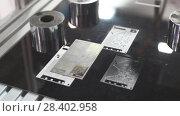 Купить «Laser engraver prints the layout of the printed circuit board», видеоролик № 28402958, снято 3 мая 2018 г. (c) Андрей Радченко / Фотобанк Лори