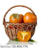 Купить «Persimmon in wicker basket, near half of fruit isolated on white», фото № 28404774, снято 20 декабря 2017 г. (c) Сергей Молодиков / Фотобанк Лори