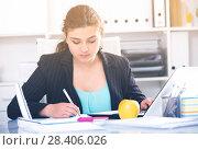 Купить «Woman beginner is having productive day at work», фото № 28406026, снято 21 мая 2017 г. (c) Яков Филимонов / Фотобанк Лори