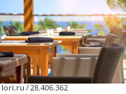Купить «Served table set at summer terrace cafe when travel in outdoors», фото № 28406362, снято 15 апреля 2018 г. (c) Happy Letters / Фотобанк Лори