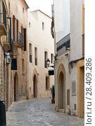 Charming empty cobblestone street of old town of Ibiza (Eivissa), Balearic Islands. Spain (2018 год). Стоковое фото, фотограф Alexander Tihonovs / Фотобанк Лори