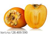 Купить «Fruit of persimmon cut in half and whole fruit isolated on white», фото № 28409590, снято 20 декабря 2017 г. (c) Сергей Молодиков / Фотобанк Лори