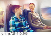 Купить «happy mother and son traveling by plane», фото № 28410306, снято 21 октября 2015 г. (c) Syda Productions / Фотобанк Лори