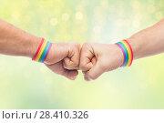 Купить «hands with gay pride wristbands make fist bump», фото № 28410326, снято 2 ноября 2017 г. (c) Syda Productions / Фотобанк Лори