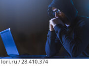 Купить «hacker with laptop computer in dark room», фото № 28410374, снято 9 ноября 2017 г. (c) Syda Productions / Фотобанк Лори