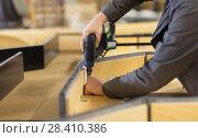 Купить «assembler with screwdriver making furniture», фото № 28410386, снято 10 ноября 2017 г. (c) Syda Productions / Фотобанк Лори