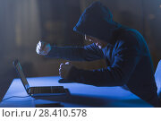 Купить «angry hacker with laptop shouting in dark room», фото № 28410578, снято 9 ноября 2017 г. (c) Syda Productions / Фотобанк Лори