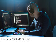 Купить «hacker with coding on laptop computer in dark room», фото № 28410750, снято 9 ноября 2017 г. (c) Syda Productions / Фотобанк Лори