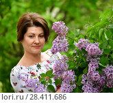 Купить «adults woman in alilac garden», фото № 28411686, снято 15 мая 2018 г. (c) Володина Ольга / Фотобанк Лори