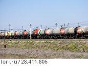 Купить «Железнодорожные вагоны для перевозки топлива. Астраханская область», эксклюзивное фото № 28411806, снято 26 апреля 2018 г. (c) Игорь Низов / Фотобанк Лори