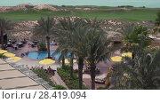 Купить «Area of hotel Park Inn by Radisson Abu Dhabi Yas Island stock footage video», видеоролик № 28419094, снято 3 апреля 2018 г. (c) Юлия Машкова / Фотобанк Лори