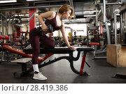 Купить «The girl in the gym with a dumbbell, in a beautiful sports uniform», фото № 28419386, снято 25 апреля 2018 г. (c) Restyler Viacheslav / Фотобанк Лори