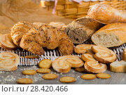 Купить «Baked goods on wicker mat», фото № 28420466, снято 30 января 2018 г. (c) Яков Филимонов / Фотобанк Лори