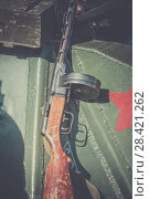 Купить «Submachine gun of Shpagin, PPSh been leaned against the armor of a tank as an illustration to the events of the Second World War», фото № 28421262, снято 20 августа 2017 г. (c) Олег Белов / Фотобанк Лори