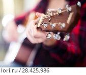Купить «girl holding guitar. Focus on the head of guitar», фото № 28425986, снято 14 февраля 2017 г. (c) Татьяна Яцевич / Фотобанк Лори