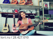 Купить «Smiling teenage girl posing with classical guitar», фото № 28427010, снято 15 октября 2018 г. (c) Яков Филимонов / Фотобанк Лори