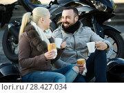 Купить «couple posing near motor bike with sandwitches and coffee», фото № 28427034, снято 22 октября 2018 г. (c) Яков Филимонов / Фотобанк Лори