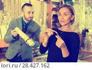 Купить «Portrait of woman customer trying bracelet», фото № 28427162, снято 16 октября 2017 г. (c) Яков Филимонов / Фотобанк Лори
