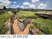 Купить «Bunkers and trenchs in Khe Sanh combat base (DMZ, Quan Tri province, Vietnam).», фото № 28430658, снято 15 августа 2015 г. (c) age Fotostock / Фотобанк Лори