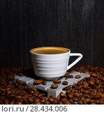 Купить «Cup of coffee on a dark background. Coffee in a white cup and coffee beans. Free space for text», фото № 28434006, снято 18 мая 2018 г. (c) ирина реброва / Фотобанк Лори