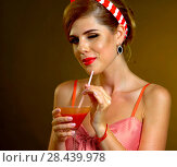 Купить «Retro woman with music vinyl record. Pin up girl drink martini cocktail», фото № 28439978, снято 12 декабря 2018 г. (c) Gennadiy Poznyakov / Фотобанк Лори