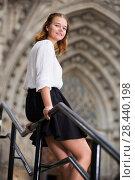 Купить «young female on handrail and the stone stairs», фото № 28440198, снято 21 марта 2019 г. (c) Яков Филимонов / Фотобанк Лори