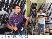 Купить «Friends choosing air-powered gun», фото № 28440402, снято 4 июля 2017 г. (c) Яков Филимонов / Фотобанк Лори